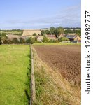 a view over farmland and a...