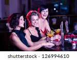 group of young women in the bar - stock photo