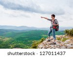girl standing on a mountain and ...   Shutterstock . vector #127011437