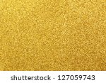 Detailed texture of glittering golden dust surface - stock photo