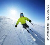 skier on piste in high mountains | Shutterstock . vector #127060733