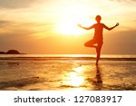backlit  young woman... | Shutterstock . vector #127083917