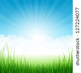 Summer landscape with grass and clouds. Vector illustration.