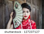 china girl chinese woman red... | Shutterstock . vector #127237127