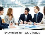 Image of business partners listening to female employee at meeting - stock photo