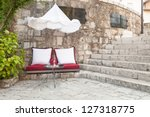 Outdoor seating on cushions in little cafe in Mostar, Bosnia - stock photo