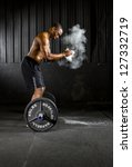 Young athlete trains with fitness equipment - stock photo
