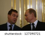BRATISLAVA - FEBRUARY 25:  Russian president Vladimir Putin, right, speaks with Kremlin chief of staff Dmitry Medvedev in Bratislava, Slovakia, on February 25, 2005. - stock photo