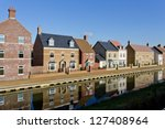 New build houses by a canal in Swindon, Wiltshire, UK. Rather than having houses built in the same style, modern luxury estates utilize a mix of styles and material. - stock photo