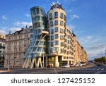 PRAGUE - SEPTEMBER 13: Modern building, also known as the Dancing House, designed by Vlado Milunic and Frank O. Gehry stands on the Rasinovo Nabrezi. Photographed on September 13, 2012 in Prague. - stock photo