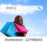 girl holding shopping bags with ... | Shutterstock . vector #127488653