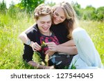 Laughing couple enjoy their time together in the park - stock photo