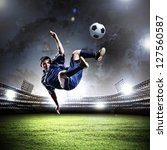 football player in blue shirt... | Shutterstock . vector #127560587