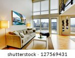 Modern loft apartment living room interior with high ceiling. - stock photo