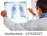doctor examining a lung... | Shutterstock . vector #127625237
