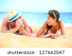 young couple having fun on... | Shutterstock . vector #127662047