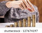 men counting money  studio shots | Shutterstock . vector #127674197
