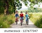 active family biking | Shutterstock . vector #127677347