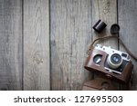 old retro camera on vintage... | Shutterstock . vector #127695503