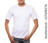 White t-shirt on a young man template isolated on white background - stock photo