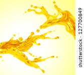 couple of liquid yellow orange juice. Dynamic liquid splash - stock photo