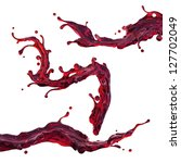 Cherry juice or red wine. Dynamic liquid splash - stock photo