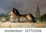 A lion statue at Trafalgar Square - stock photo