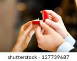 man giving an engagement ring... | Shutterstock . vector #127739687