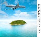 Private jet over the tropical island. Square composition. - stock photo