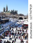OTTAWA, CANADA - FEBRUARY 9:  People celebrate the Winterlude festival in CanadaÂ?Â?s capital on the frozen Rideau Canal, the worldÂ?Â?s largest outdoor skating rink.  February 9, 2013 in Ottawa Ontario. - stock photo