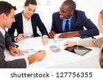 group of business people having meeting together - stock photo