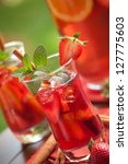 Closeup of two glass of spicy strawberry Sangria on outside table. - stock photo