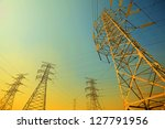 The transmission power towers of sky background - stock photo
