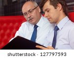 two successful businessmen... | Shutterstock . vector #127797593