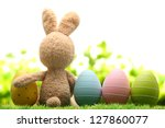 Stock photo sugar rabbit and easter eggs on meadow 127860077