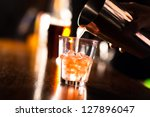 barman pouring a cocktail into... | Shutterstock . vector #127896047