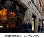 ROME - MARCH 13:  Luxury shopping along Via Condotti in Rome, Italy, on March 13, 2005. Shoppers window shop at a Gucci salon. - stock photo