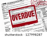 bold red overdue stamp on 1040 income tax form - stock photo