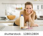 Portrait of smiling young woman with snacks - stock photo