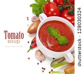 Traditional tomato soup and ingredients (with easy removable sample text) - stock photo