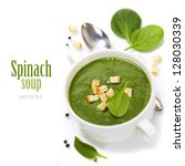 Traditional Spinach cream soup with croutons and fresh spinach leaf on top (with easy removable sample text) - stock photo