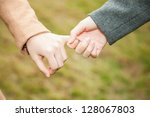 two female teens hold hand... | Shutterstock . vector #128067803