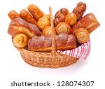 Lots of sweet bakery products in basket on background - stock photo