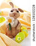 Easter bunny with painted Easter eggs. - stock photo