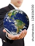 Businessman Holding World Map Globe, Earth image provided by NASA - stock photo
