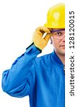 Young  construction worker with helmet and goggles on white background - stock photo