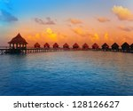 houses on piles on water at the ... | Shutterstock . vector #128126627