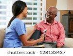 nurse visiting senior male... | Shutterstock . vector #128133437