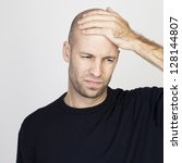 bald man with headache - stock photo