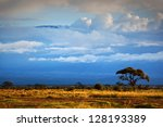 Mount Kilimanjaro partly in clouds, view from savanna landscape in Amboseli, Kenya, Africa - stock photo